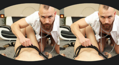 Still from VR porn movie of bearded man with mohawk hair pulling at a womans panties