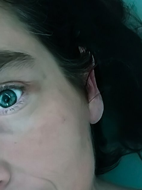 Close up of mollys eyes and hair in turquise bath water