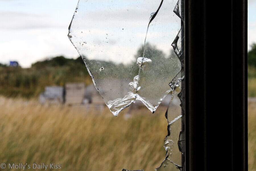 broken glass in window for post about taking time off from relationships