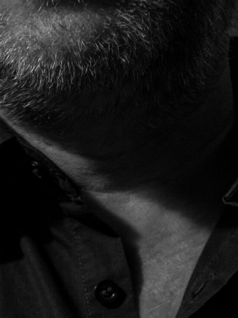 close up shot of Michaels bearded chin and collar of his shirt