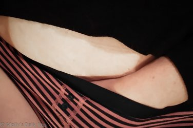 Cropped image of mollys hand sliding into her knickers