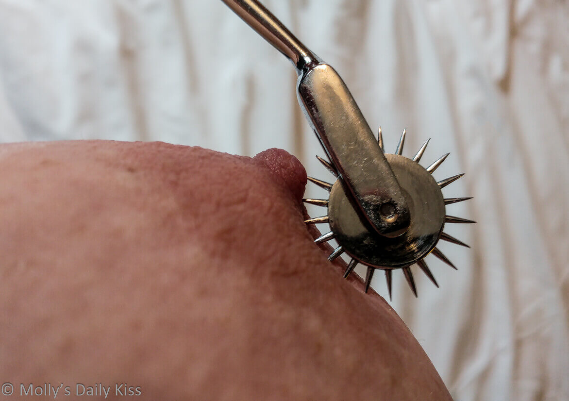 Macro shot of pinwheel running over molly's nipple