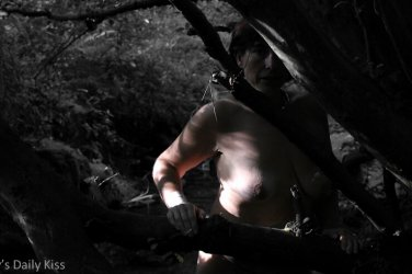 molly naked looking through the trees like prey
