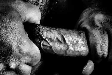 cropped image of mans hands holding his penis by hexereihex