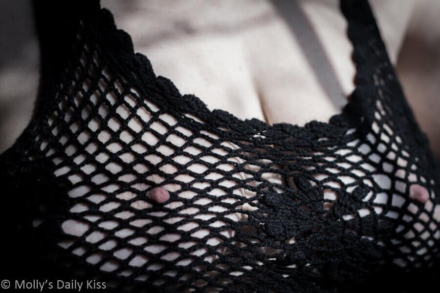 Molly's nipples poking through black net top