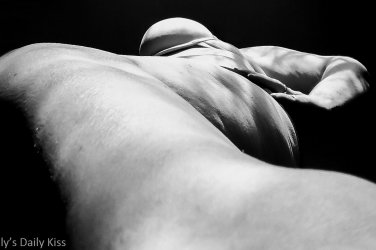abstract image looking up molly's leg to her underboob in high contrast black and white