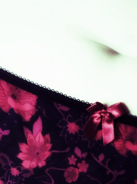 Waistband of panties with bow and molly's belly button