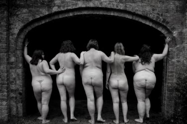 Five naked woman standing with backs to the camera in archway for post called in the compnay of women