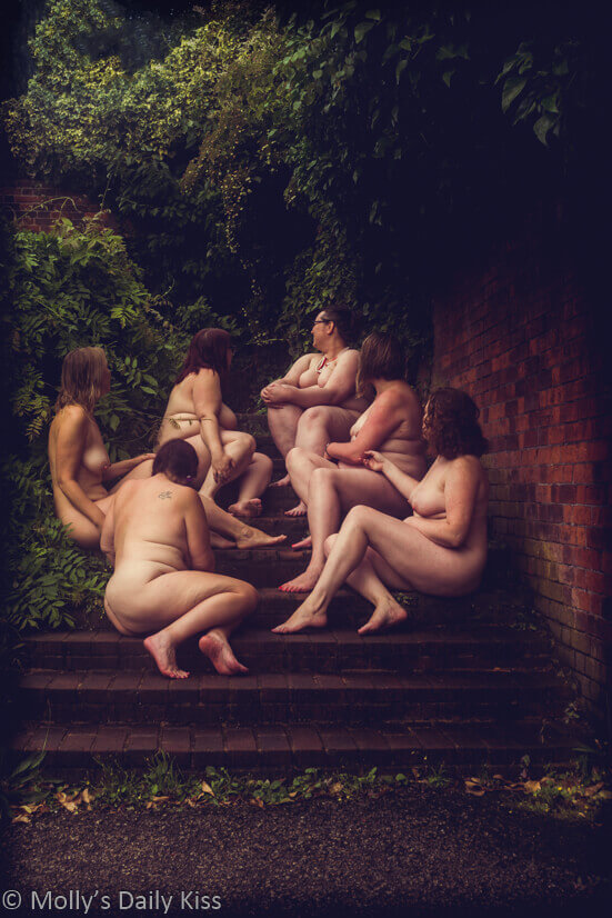 Six woman all naked sitting on the steps of old english garden for a post called in the company of women