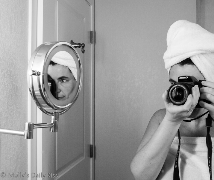 Molly taking a self portrait in bathroom mirror with double reflection in small vanity mirror for both about end of 2019 and 10 years of blogging