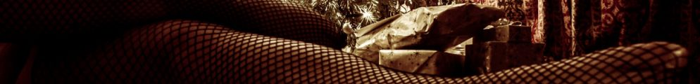 molly laying on front of christmas tree in fishnet stockings for post about fuck list