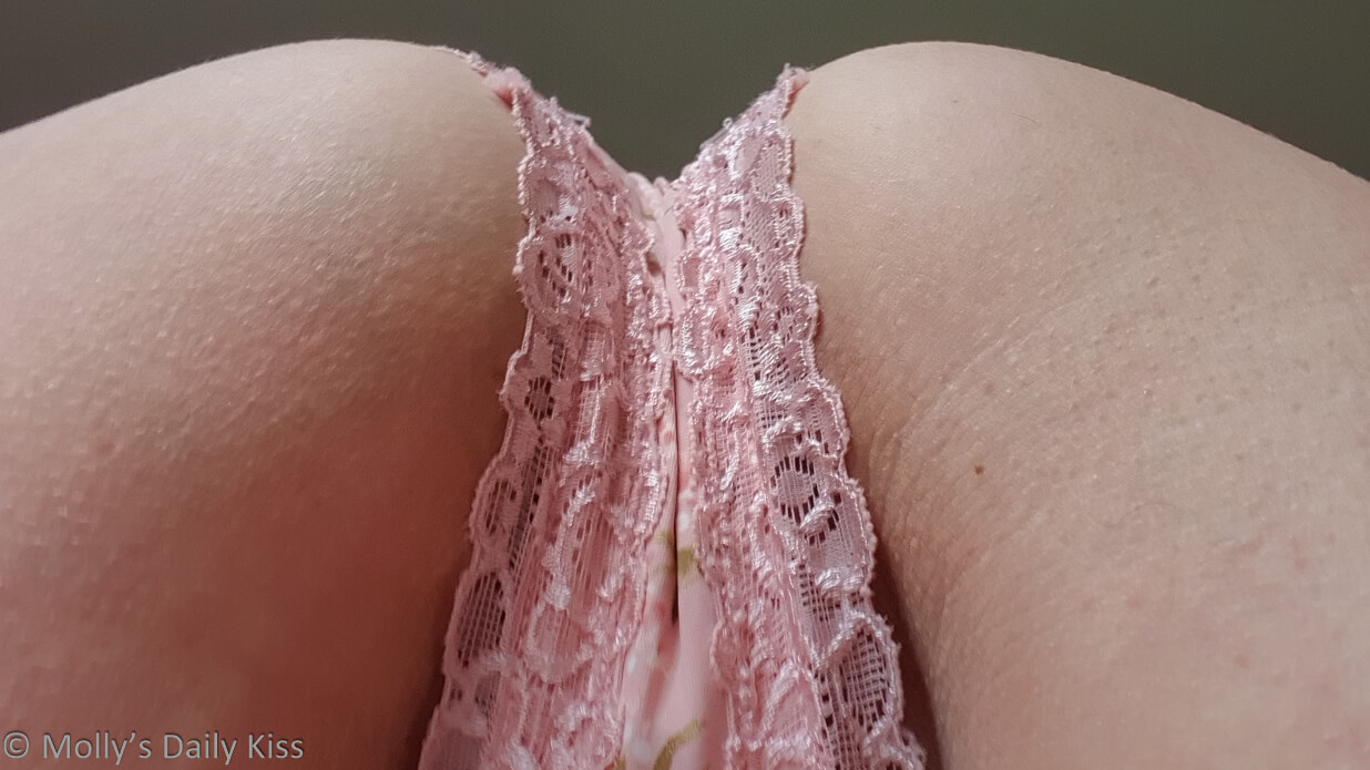 Looking up through molly's legs to her bum with pink panties for post called bottoms up