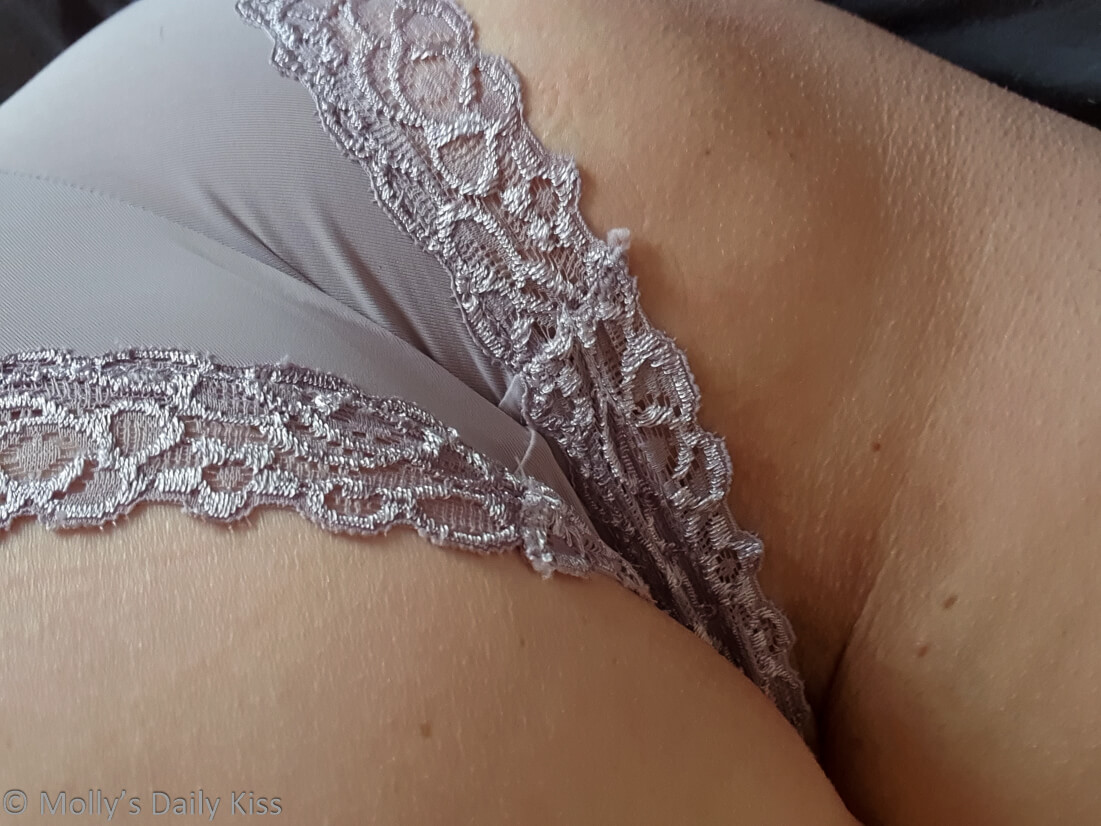 close up of mollys lilac lace knickers which have been well traveled