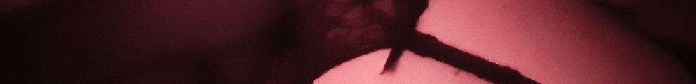 Looking down on mollys legs wearing stockings and suspenders is anticipation of pleasure