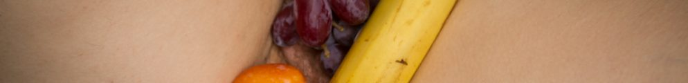 Mollys legs open with various fruit piled over her vulva for post called fruit and vag