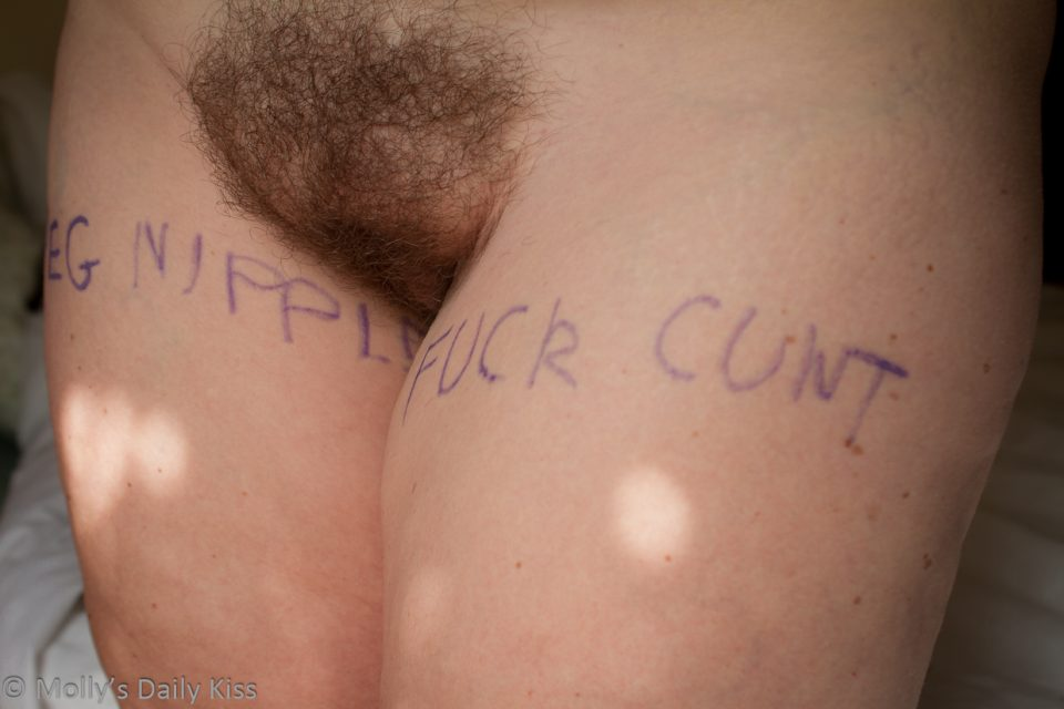 lists written across womans thigh with hairy bush pubes