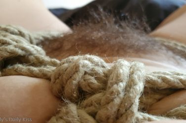 Looking down past knotted rope to pubic threads