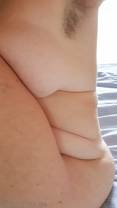 Side view of molly showing her curves and lines of fat with her armpit hair showing
