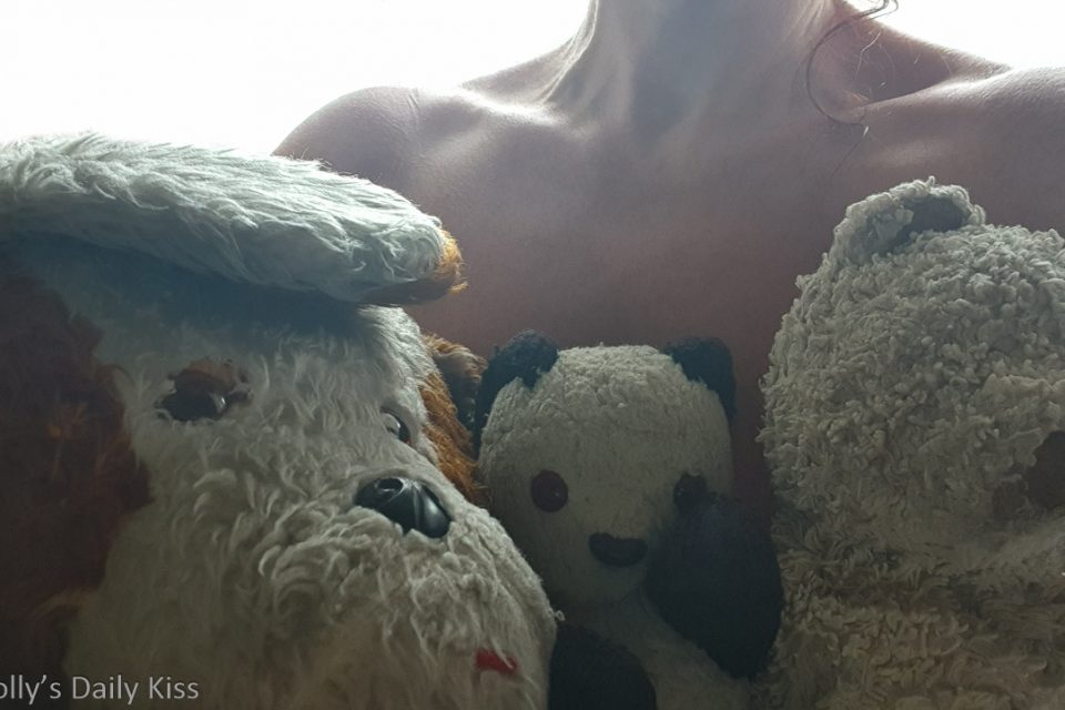 Molly topless holding her three teddy bear