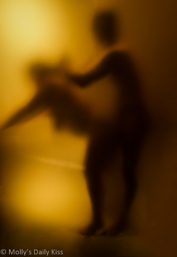 Silhouette of Molly standing being fucked from behind by a man