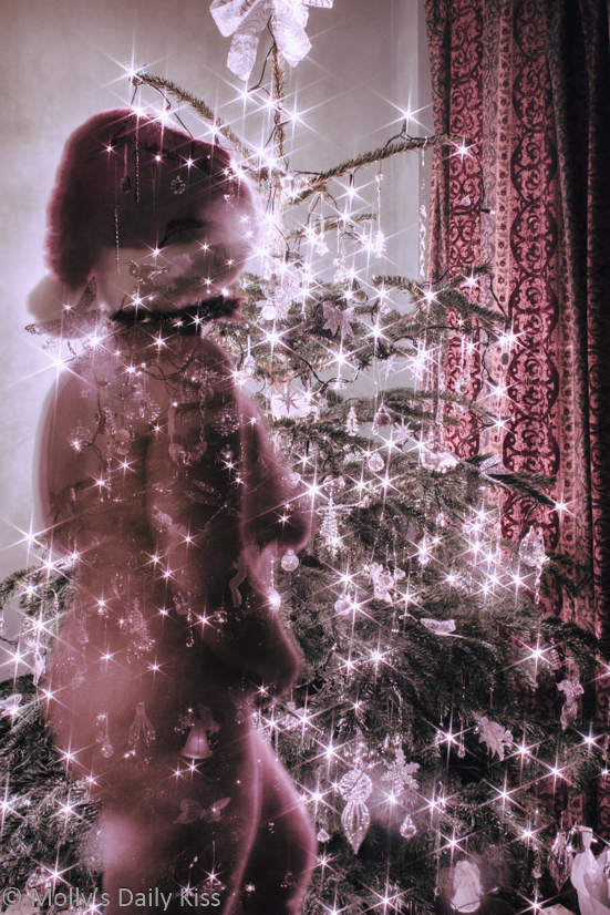 Double exposure of molly in front of Christmas tree to look like christmas ghost