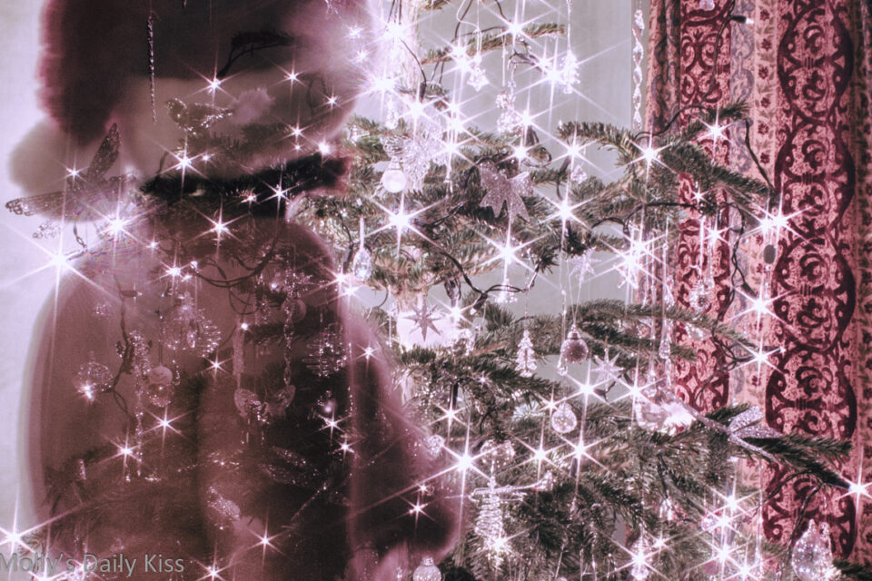 cropped image of molly topless in front of christmas tree double exposure