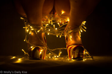 molly in high heels with christmnas lights round her ankle and her vulva showing betweenher legs for light of love post