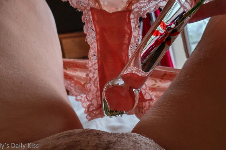 Molly with her knickers down and glass dildo pressed up against her pubes for a post called serious thing