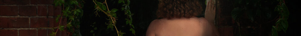 cropped image of naked woman standing at doorway to secret garden