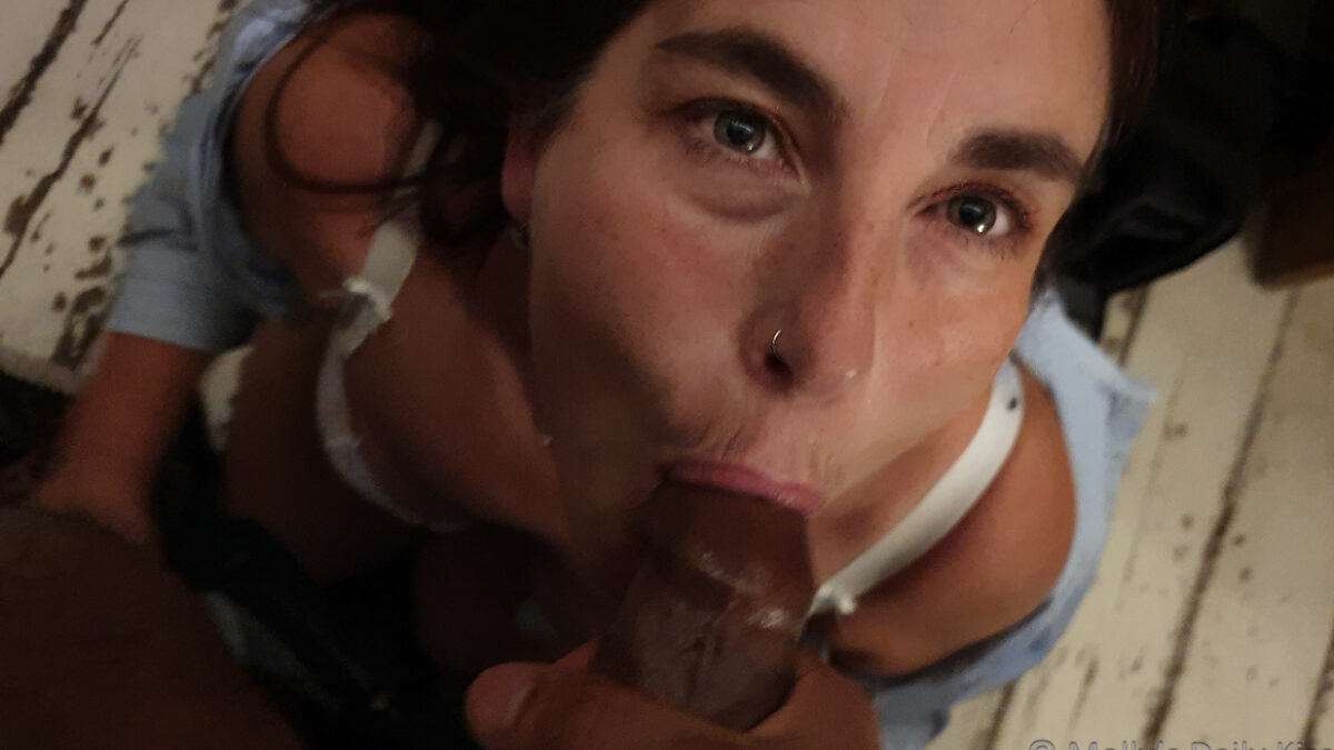 Molly cock sucking looking up at camera with penis in her mouth