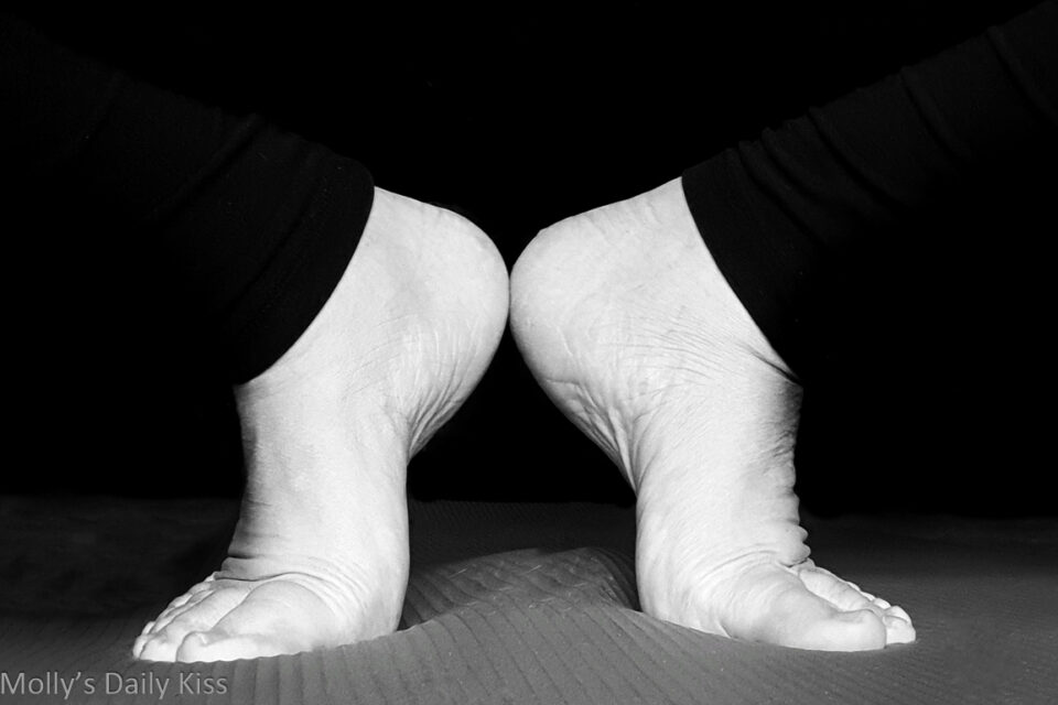 mollys feet in yummy yoga pose on yoga matt in black and white