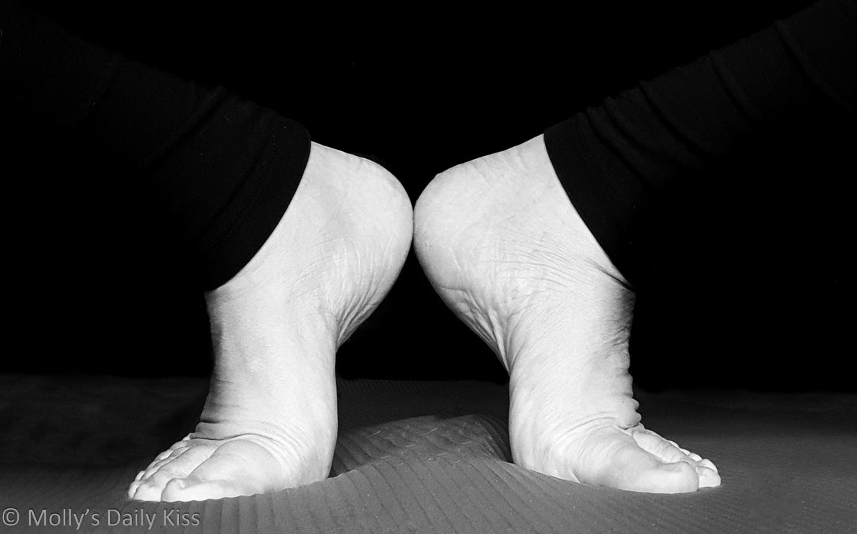 mollys feet in yummy yoga pose on yoga matt in black and white