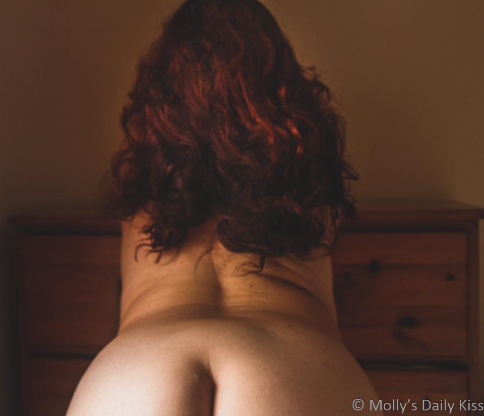 Looking at mollys back with top of her bum just visable and long auburn hair running down her back for post called measured