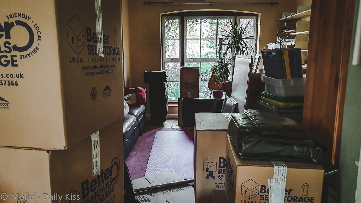 Looking through front room past moving boxes for post about moving on