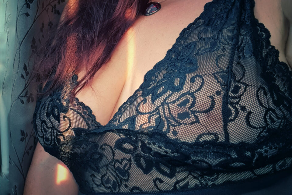 Sunshine on mollys chest showing off the black lacy lingerie she is wearing