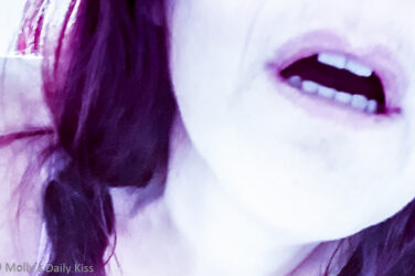 Cropped image of molly mouth open with purple highlighted hair for post called Cuckboy