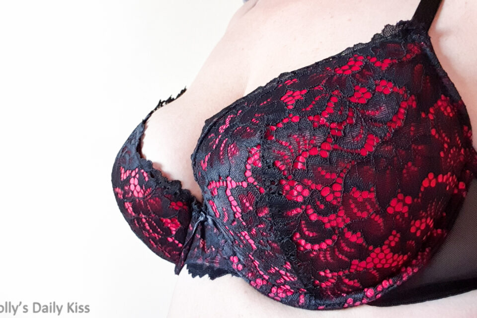 Side view of molly's breasts in black and red bra for post called Seven Seconds