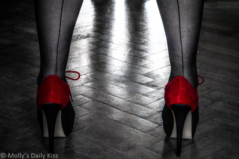 Molly in red and black heels standing with her legs apart from post about age gaps