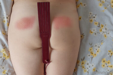 Looking down at molly's bottom with red spank marks on it andLiebe Seele Leather Split Tawse Paddle