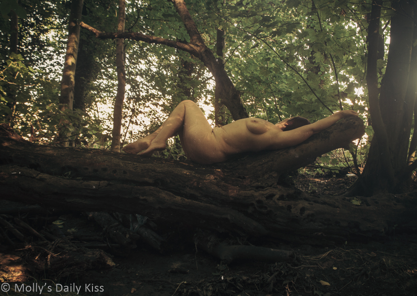 poetical justice is molly laying naked on falled tree in the woods
