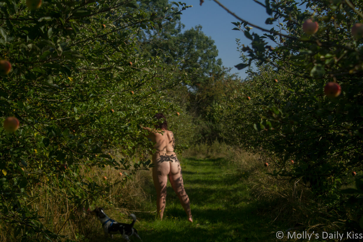 Molly naked in Apple Orchard with her little dog by her feet